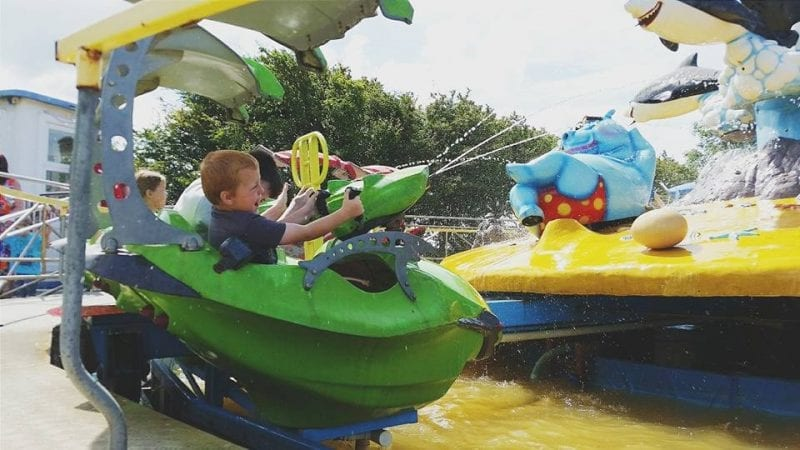 Kid on amusement in somerset